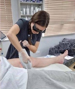 Skin expert in Christchurch Dorset Kirsty Campbell doing a laser treatment